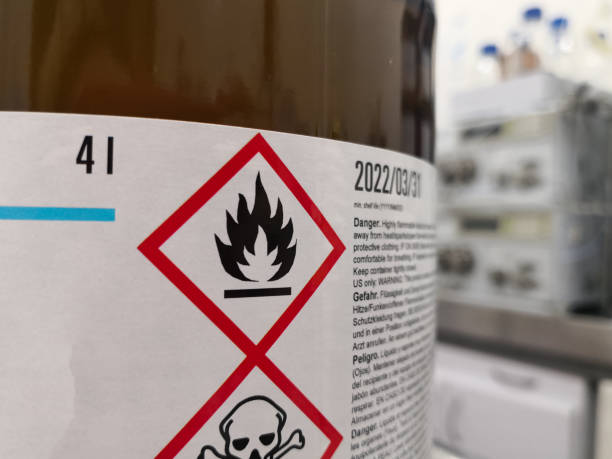 Label of a hazardous flammable chemical in a scientific laboratory Label of a hazardous chemical in a scientific laboratory. Warning icons on flammability and toxicity. hazardous chemicals stock pictures, royalty-free photos & images