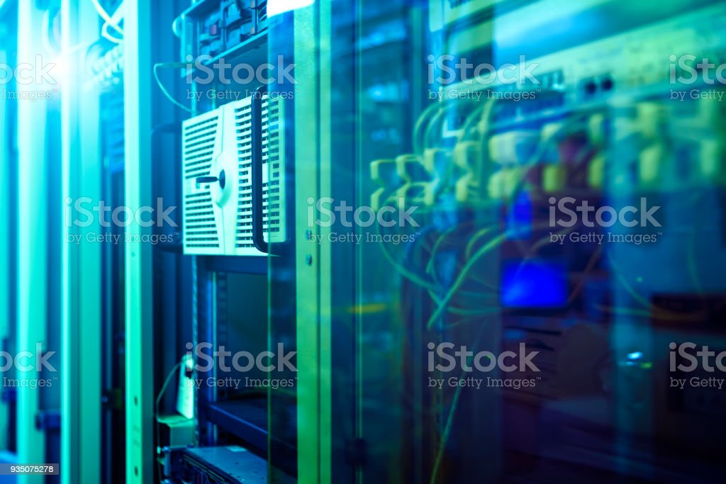 label of fiber optic cable and high speed network router switch in a technology data center room . blur background stock photo