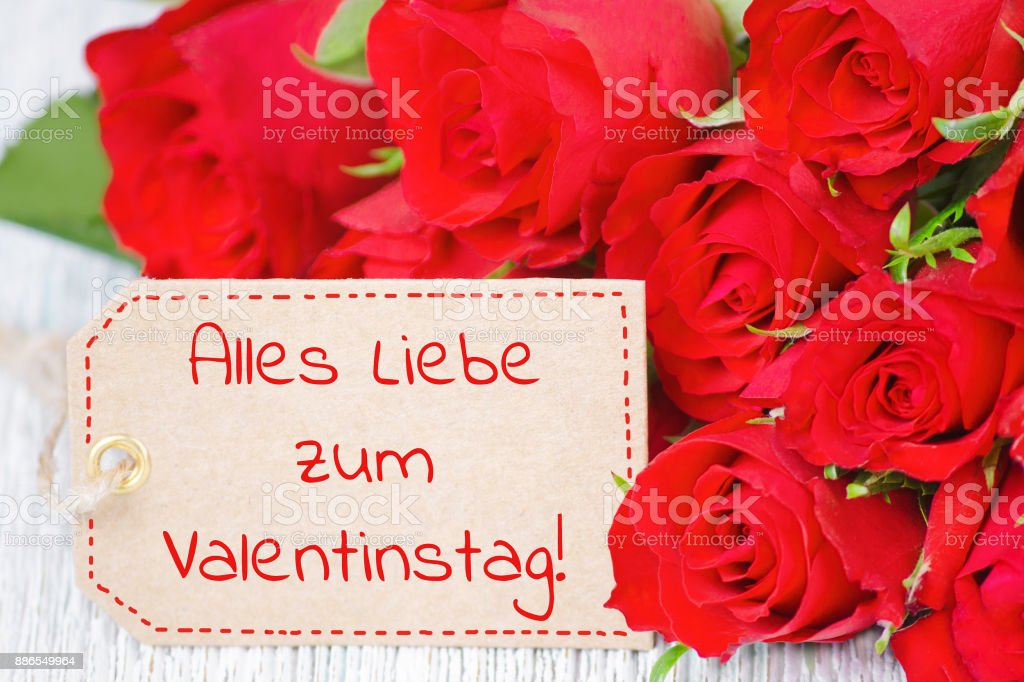 label with german text happy valentines day and red rose flowers royalty free stock photo