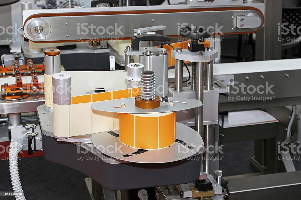 A labeling machine in a work station stock photo