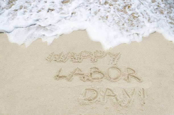 dia do trabalho de fundo na praia - dia do trabalhador - fotografias e filmes do acervo
