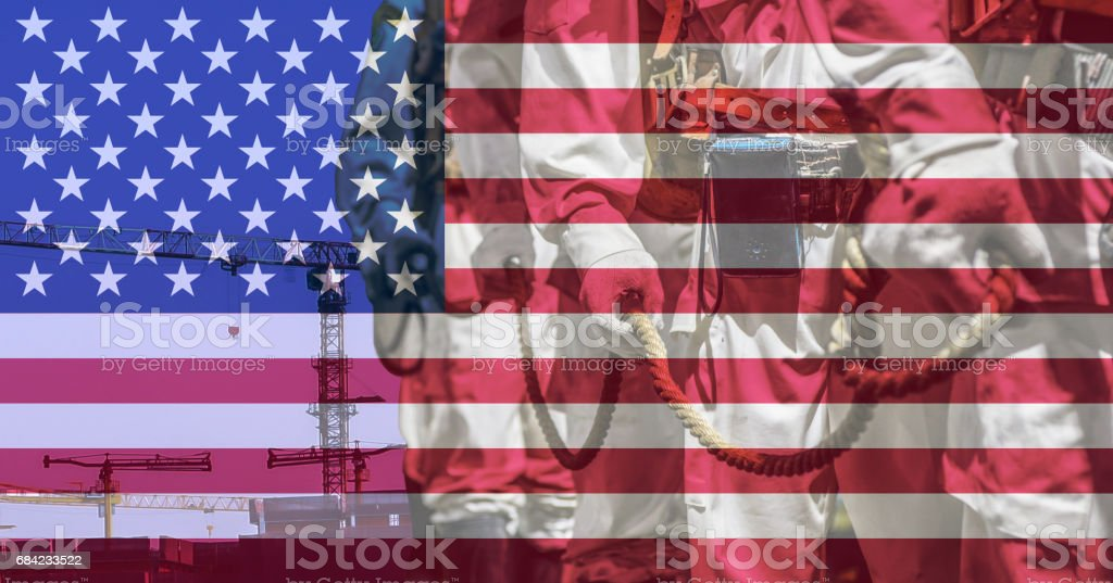 Labor day concept with background the American flag and the labor side royalty-free stock photo