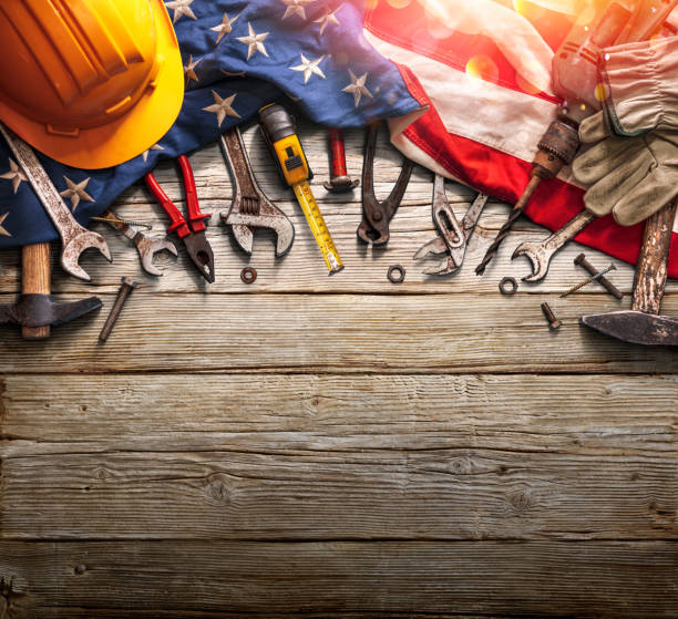 Labor Day - National Holiday - Mechanic Tools And Usa Flag On Woden Background stock photo