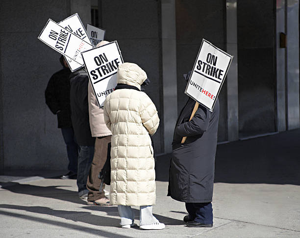 Labor Dispute Workers on strike outside a hotel labor union stock pictures, royalty-free photos & images