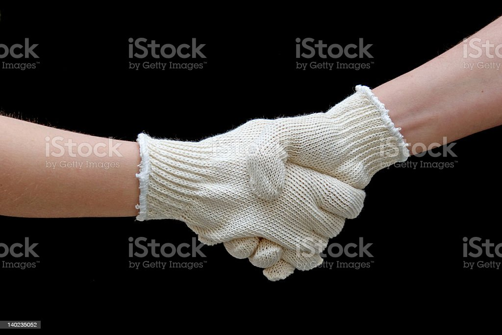 Labor handshake with safety gloves isolated on black royalty-free stock photo