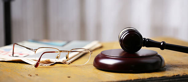 Labor law concept, gavel, glasses and newspaper on wooden table – Foto