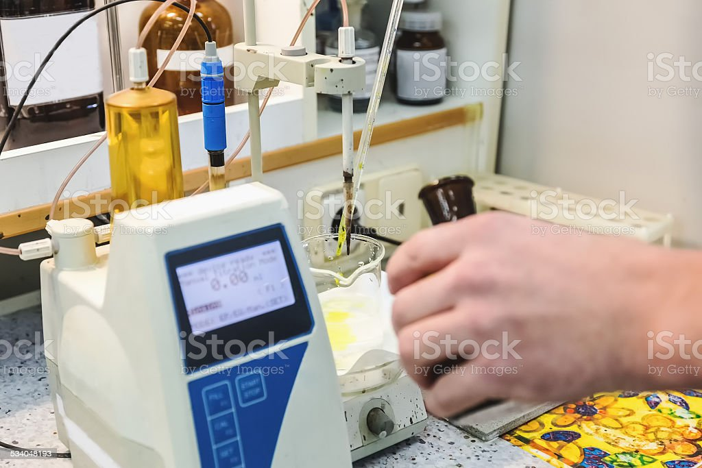 Laborant makes test in laboratory stock photo