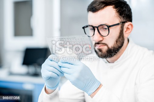 istock Laboratory assistant working with bacteria 946451058