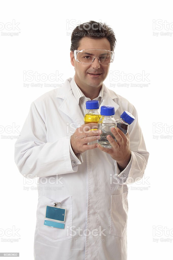 Laboratory chemist holding bottles of chemicals royalty-free stock photo