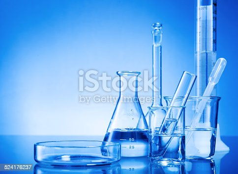 891126112istockphoto Laboratory equipment, glass flasks, pipettes on blue background 524176237
