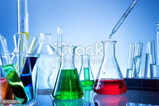 891126112istockphoto Laboratory equipment, lots of glass filled with colorful liquids 524234519