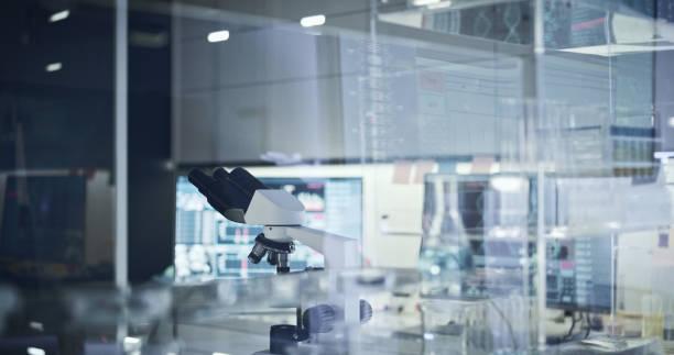 Laboratory equipment. Microscope and glassware stock photo