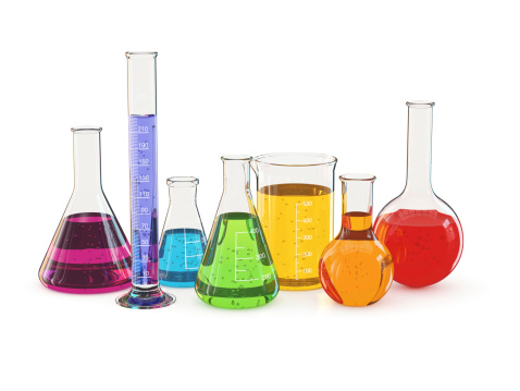 Laboratory glassware with a colorful liquid, isolated on white background.