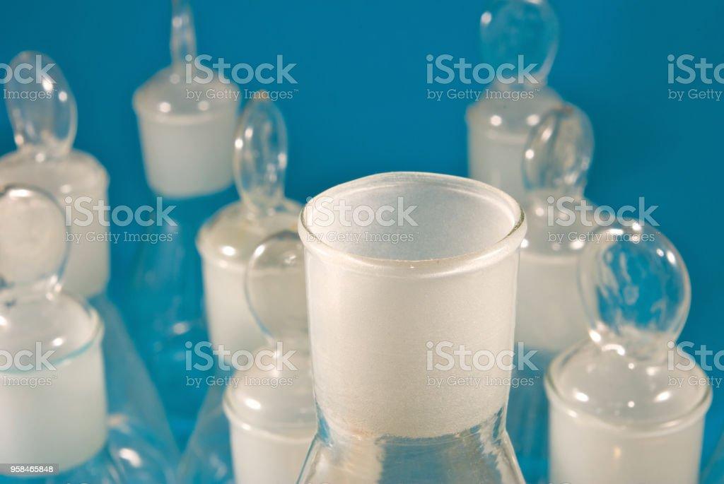 laboratory flasks on a blue background stock photo