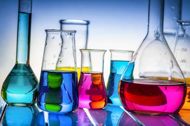 laboratory glass filled with chemical liquids. - campione scientifico foto e immagini stock
