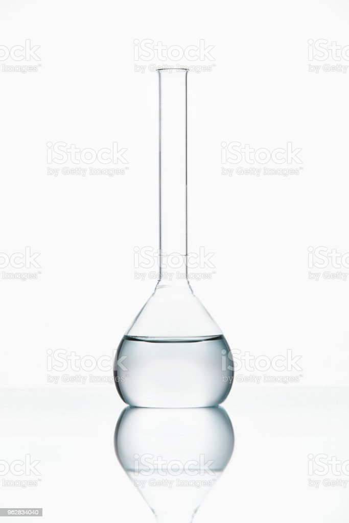 Laboratory Glass With Transparent Liquid - Foto stock royalty-free di Attrezzatura