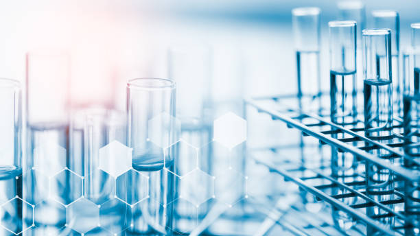 laboratory glassware containing chemical liquid, science research,science background - becher foto e immagini stock