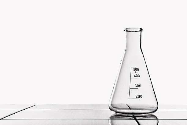 Laboratory glassware on the tiled table. stock photo