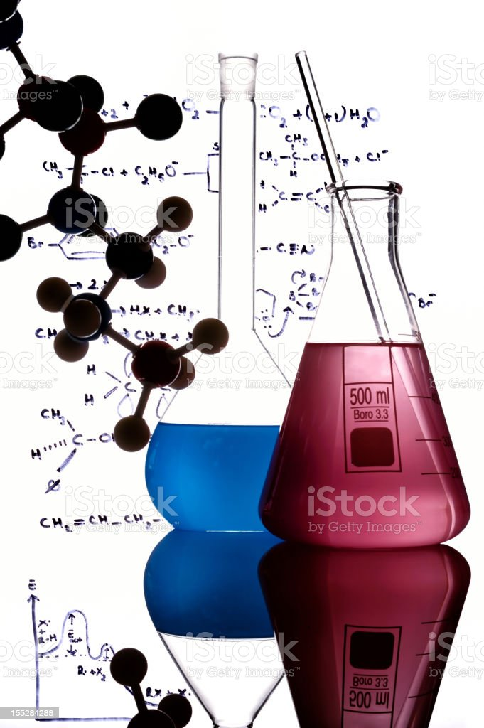 Laboratory glassware surrounded by formulas and molecules stock photo