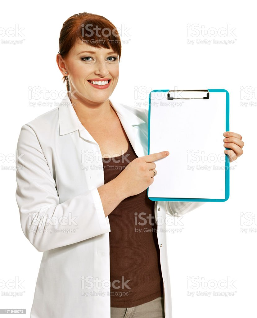 Laboratory Portrait of young laboratory technican standing with clipboard and smiling at camera. Studio shot, white background. 20-29 Years Stock Photo