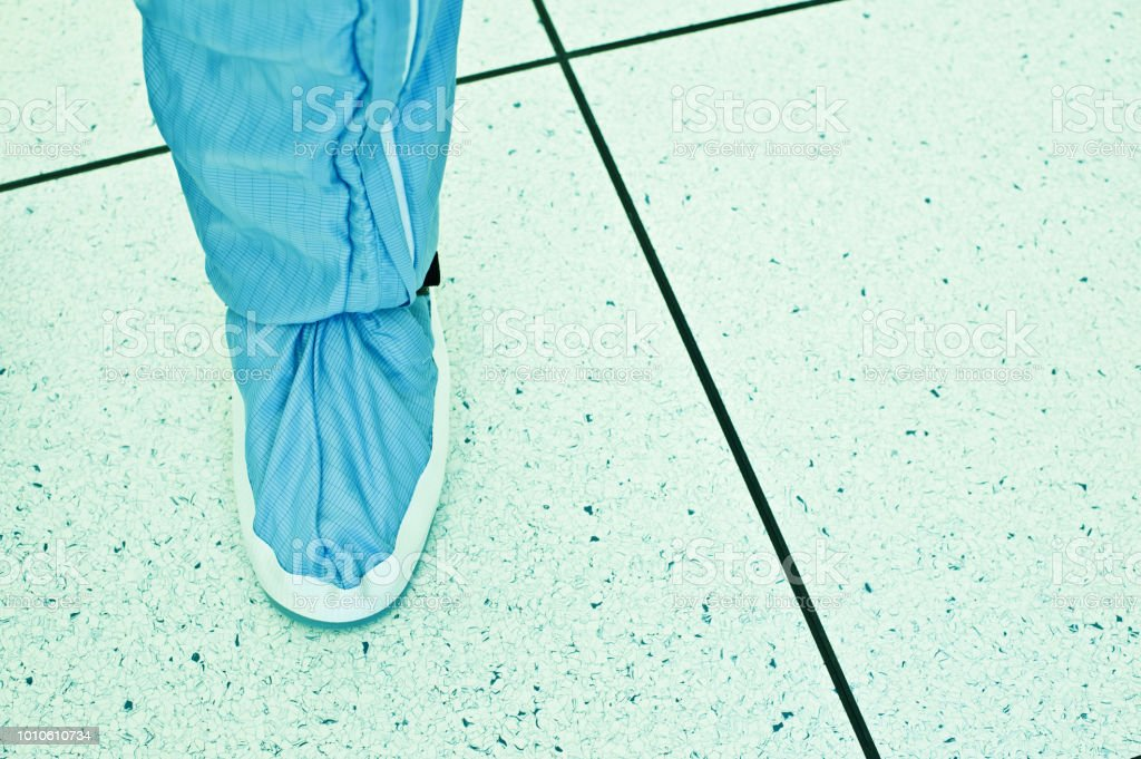 Laboratory Protective Footwear. Scientist Standing In The Cleanroom