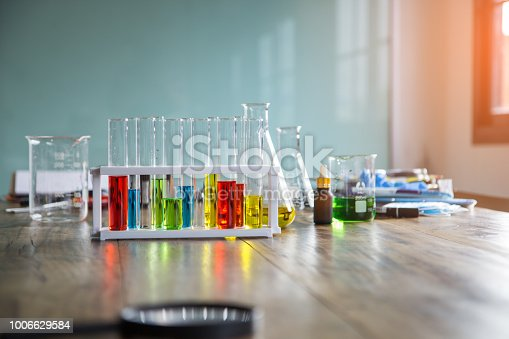 891126112istockphoto Laboratory Research - Scientific Glassware For Chemical Background with colorful chemical reagent in research laboratory science concept. 1006629584