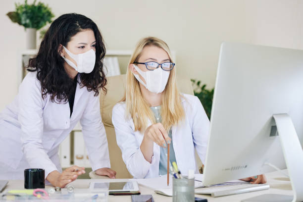 Laboratory researchers discussing tests results stock photo