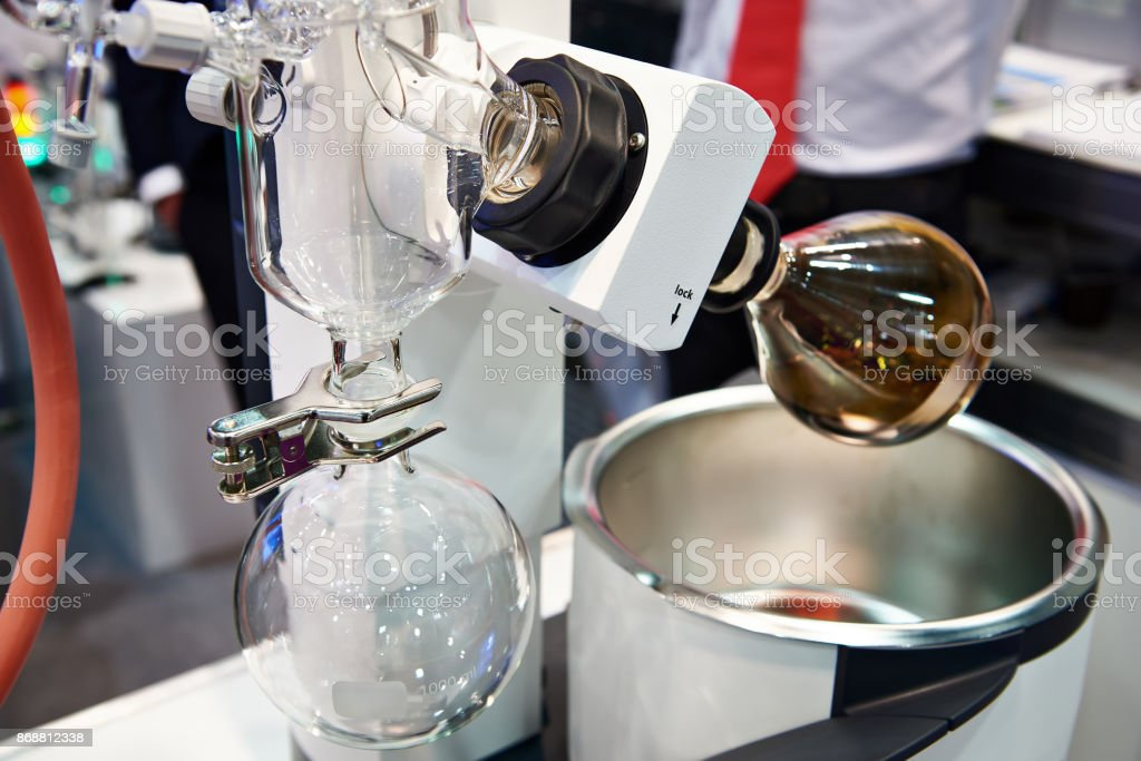 Laboratory rotary evaporator with chemical preparation in flask stock photo