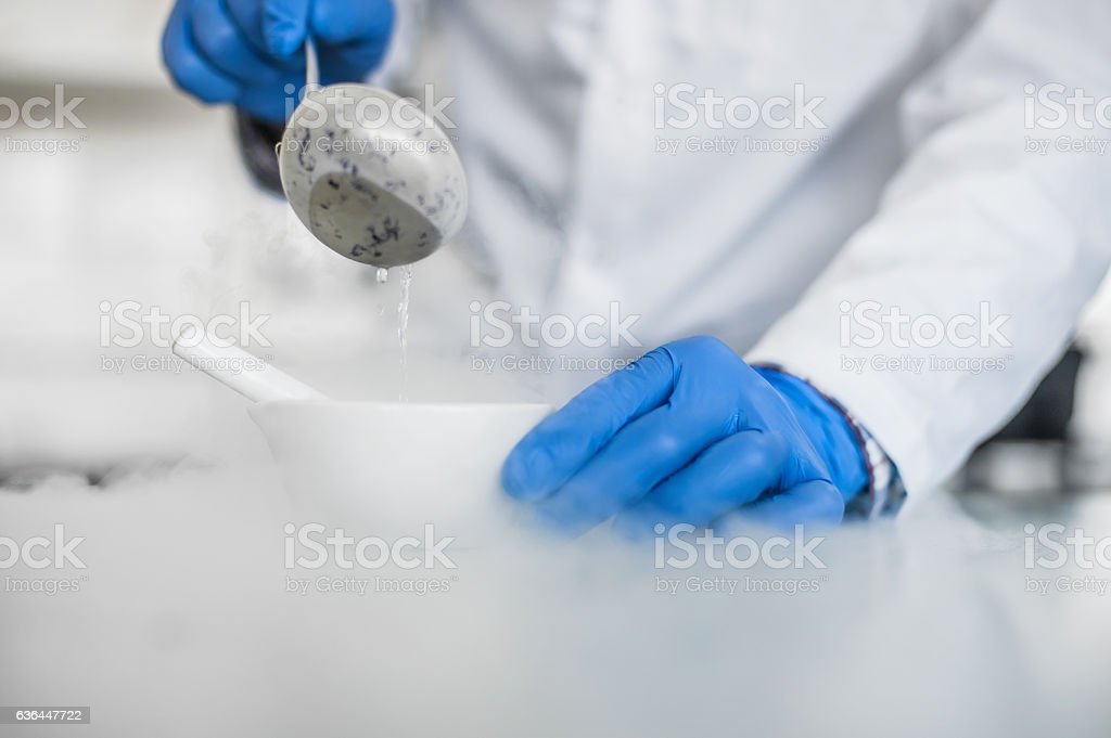 Laboratory technician performs an experiment with liquid nitroge stock photo