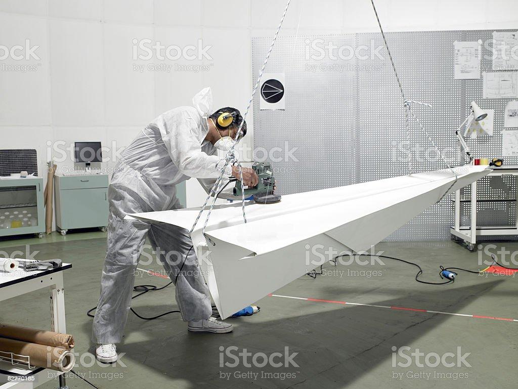laboratory technician sanding paper plane royalty free stockfoto