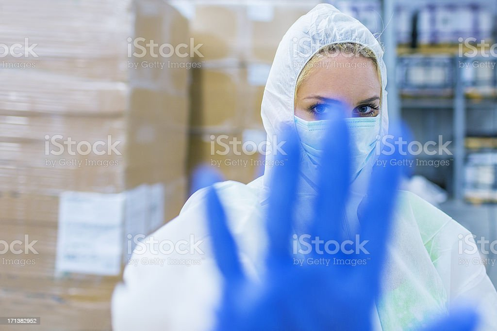 Laboratory technician signaling restricted area stock photo