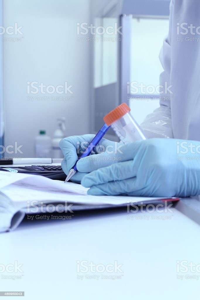 Laboratory Technician write test results from lab royalty-free stock photo