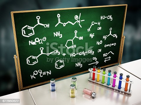 874157676istockphoto Laboratory tubes and chemicals standing on top of the table. Blackboard with chemistry formulas on the background 672950522