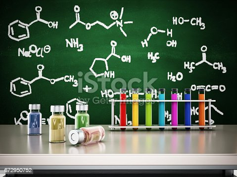 874157676istockphoto Laboratory tubes and chemicals standing on top of the table. Blackboard with chemistry formulas on the background 672950752