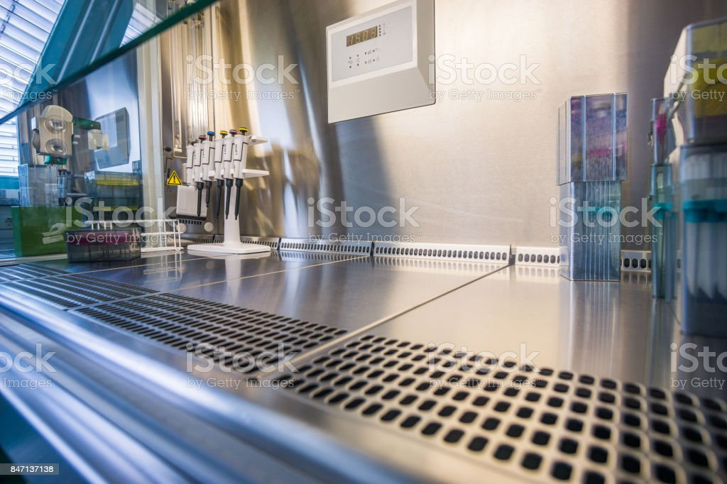 Laboratory work at a blank steril bank. Cell splitting work. stock photo