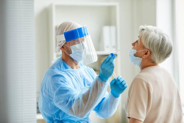 Laboratory Worker With Senior Woman stock photo