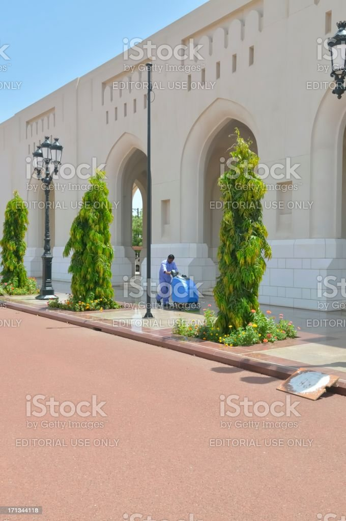 Laborer Cleaning Sultans Sidewalk royalty-free stock photo