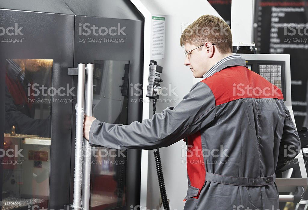 laborer working with machine tool royalty-free stock photo