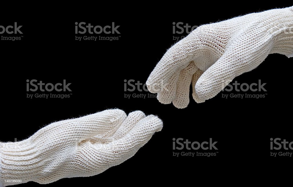 Labor's hands in safety gloves conection. isolated on black stock photo
