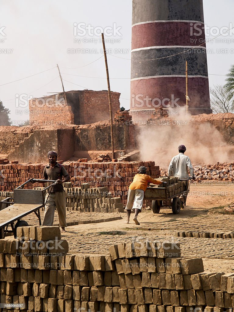 Labourers in poor working conditions at a Bangladesh Brick factory stock photo