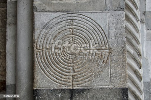857874170 istock photo Labyrinth engraved in the marble of a church 693668420