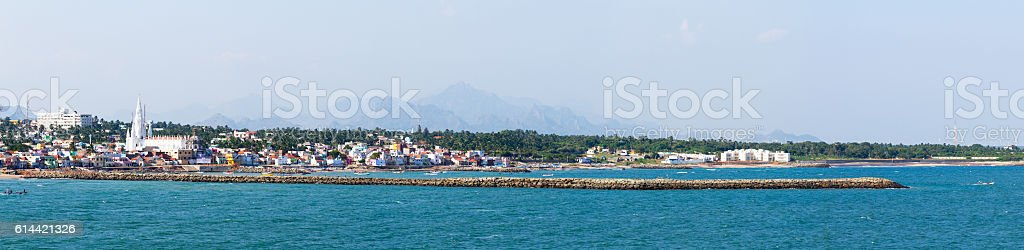 Laccadive Sea and Kanyakumari town on the background of mountains stock photo