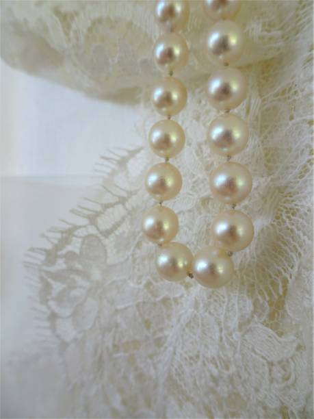 Lace and white pearls stock photo