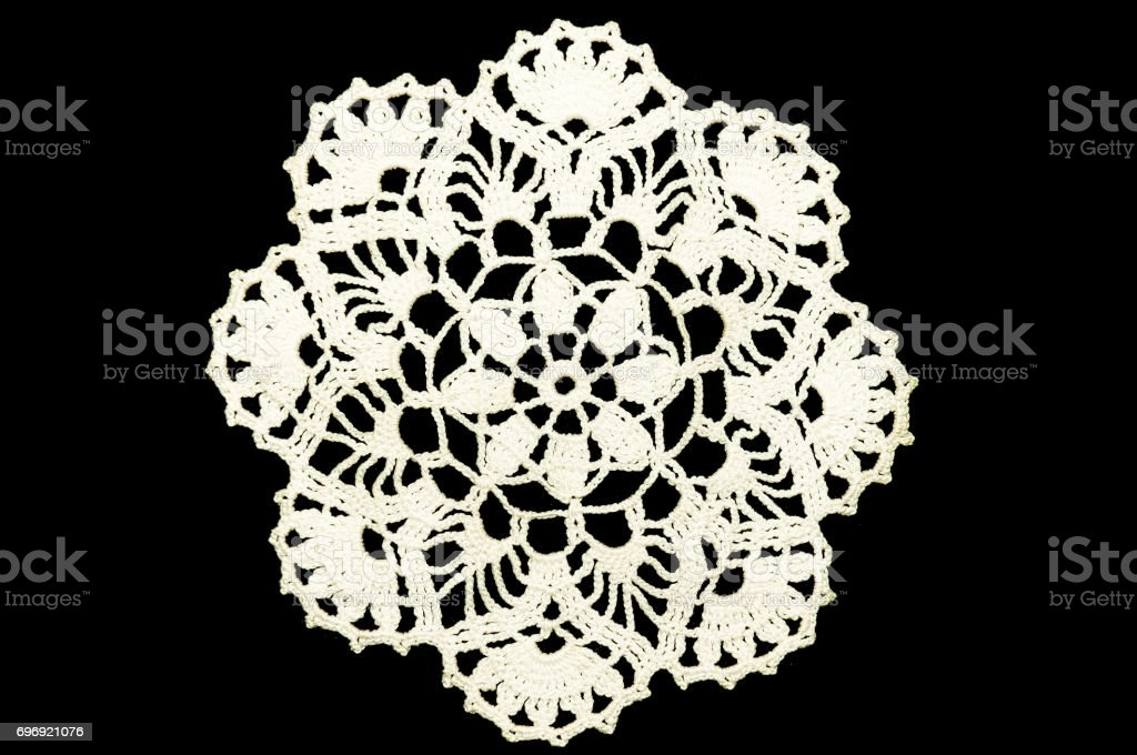 Lace doily. Black background, not isolated. stock photo