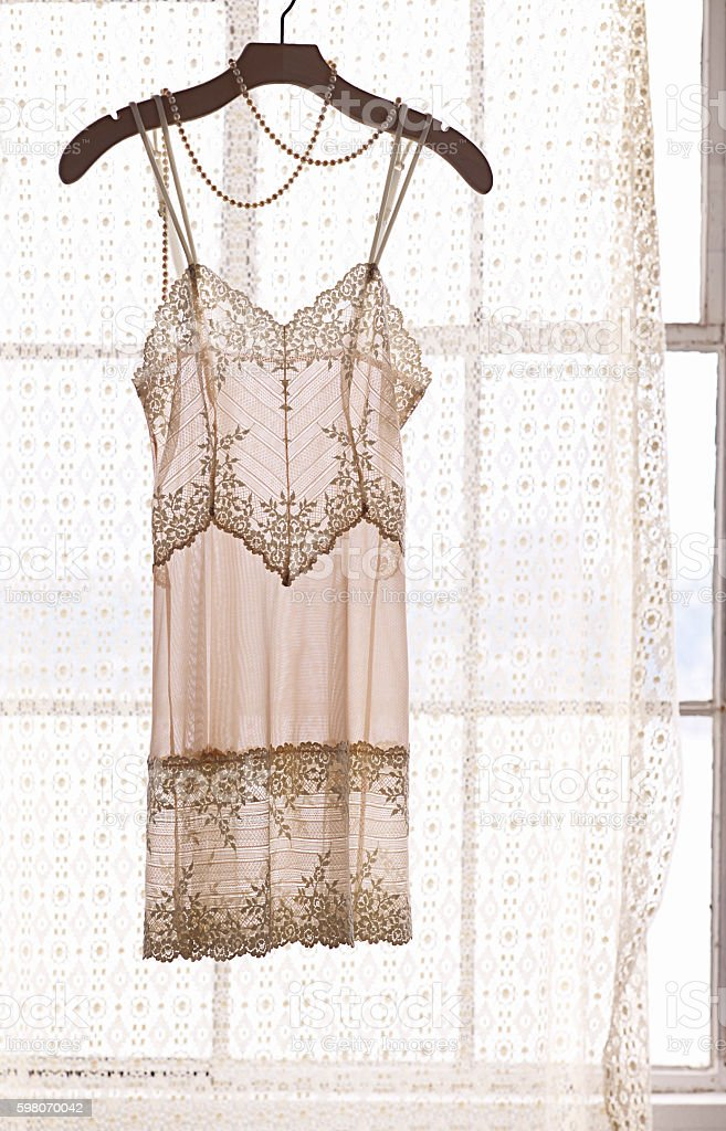 lace lingerie in window stock photo