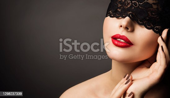 Lace Mask and Red Lips, Beautiful Woman Fantasy, Black Bandage Hide Young Model Face. black studio background Copy Space