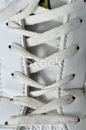 Laced sneaker - laced footwear photo