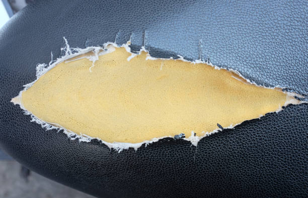Lacerated motorcycle seat. stock photo