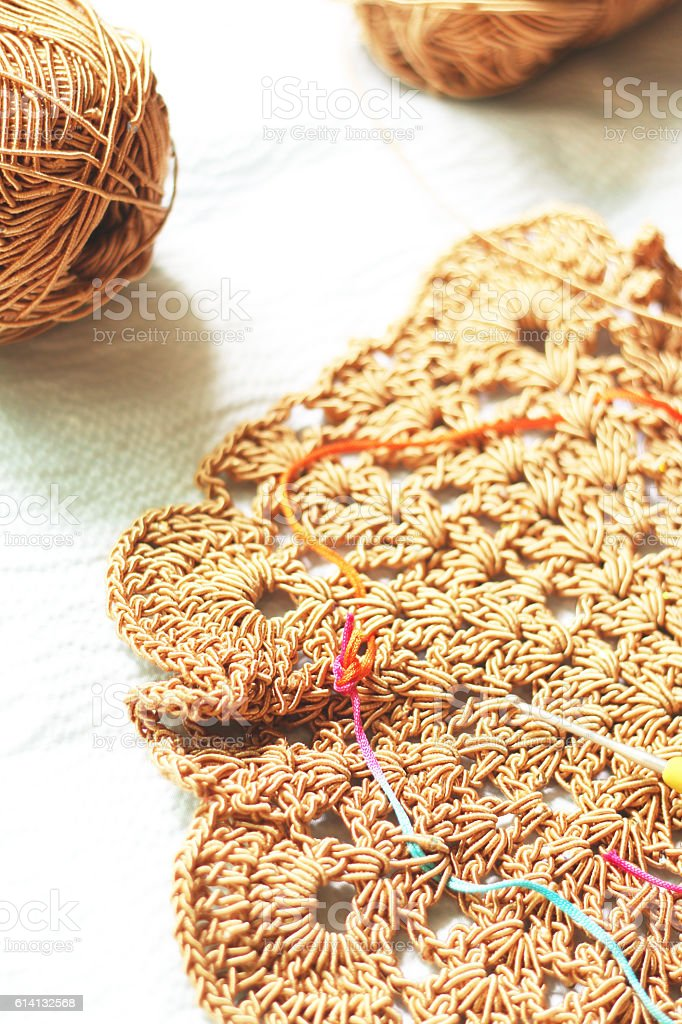 Lacework and balls of wool stock photo