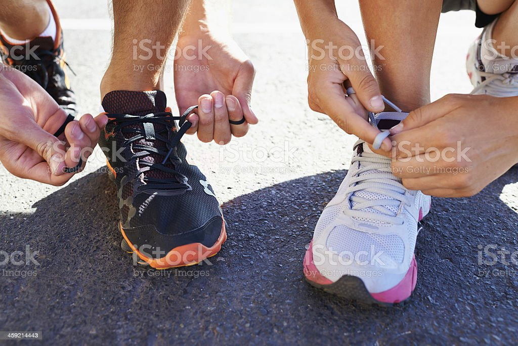 Lacing up before the run stock photo